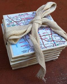 Cheap Decorating Ideas: I love coaster projects! They're quick, easy, and fun! There are so many ways to get creative with them. These coasters are decorated with maps. What a great way to add a personal touch to your house. Use maps of special places you've visited. They also make great gifts! Map Coasters Tutorial