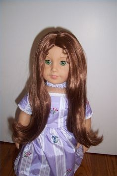 """How to recondition doll's hair:  I've read this but my doll has """"sausage curls"""" that were played with a great deal by some little girl.  How would I go about keeping the curls intact????"""