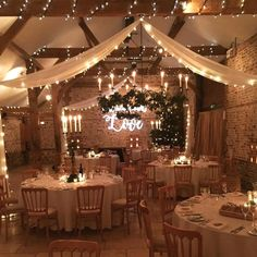 The South Barn with stunning winter wedding decor this week. Ivy clad candelabra… The South Barn with stunning winter wedding decor this week. Ivy clad candelabras, drapes lined with fairy lights, gobo projection on the… Winter Wedding Decorations, Wedding Themes, Our Wedding, Dream Wedding, Wedding Week, Light Wedding, Wedding String Lights, Wedding Parties, Wedding Reception