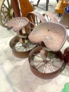 """Packer Wheel Tractor Seat Barstools  $60.00 ea  Rustiquities Vendor """"BL"""" or """" pumpkin guy""""  Red Barn 305 W Madison Waxahachie, Tx 75165  Open: Wed-Sat.   9:00 to 5:00 Sunday.     11:00 t"""