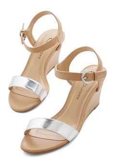 Draw the Line Sandal in Silver. These colorblocked wedge sandals from CL by Laundry offer the perfect mix of timelessness and on-trend style! NaN