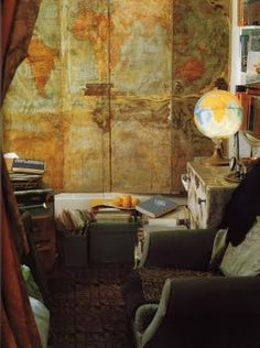 "In the Paris bedroom of oceanographer Anita Conti, the folding doors of her built-in wardrobe are layered with shellacked maps of the world. Image by Guy Hervais for ""The World of Interiors""."