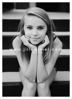 senior on steps. I like this but only if the subject has more clothes on. This pose makes this girl look naked.
