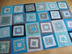 Square in square quilt.  Would make a great picnic blanket top.
