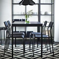 Color coordinated dining rooms - IKEA black dining table with black chairs and a black-brown storage combination. Click for item list!