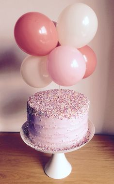 Little girls hundreds and thousands birthday cake with mini balloon topper xxx