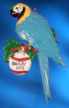 """Personalized Bird Christmas Ornament - Blue & Gold Macaw.  Buy it now at www.ornamentswithlove.com for $12.99 Can be found in the """"pets and animals"""" category."""