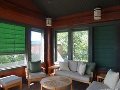 Screen porch with external shades to protect your furnishings. They are operated from the inside.