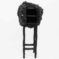 The unusual Cocoons Cabinet 5 was created by French designer Marlène Huissoud, and looks like it is covered in blocks of coal.