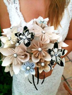 Origami Bouquet - A very inventive alternative to the traditional bouquet. Origami mixed with added decorations provide a longer lasting memento of the occasion and a fantastic style statement for that special day.