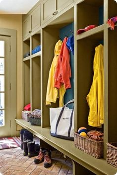 Mudroom floor-to-ceiling cubbies... hide the winter stuff up top. :)