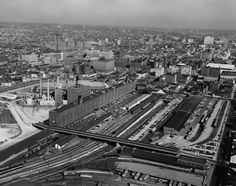 AERIAL VIEW OF STATION, YARDS AND BONDED WAREHOUSE, LOOKING NORTHWEST - Baltimore & Ohio Railroad, Camden Station, South side of Camden Street between Eutaw & Howard Streets, Baltimore, Independent City, MD