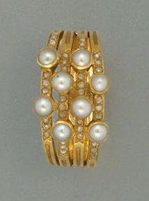 A late Victorian half pearl and diamond multi-hoop ring, circa 1890.