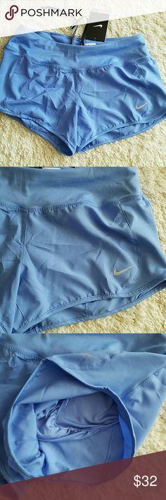 NWT NIKE Dri fit running shorts size small . Nike Shorts