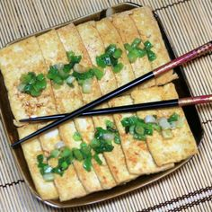 Pan-fried strips of tofu are topped with sizzling green onions and soy sauce in this simple vegetarian recipe needing only 4 ingredients. Fried Chicken Recipes, Tofu Recipes, Vegetarian Recipes Easy, Easy Dinner Recipes, Healthy Recipes, Tofu Protein, Pan Fried Tofu, Dinner Suggestions, Grilled Tofu
