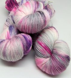 My Monkeys Fly is a fun colorway that starts with a cream/gray base and has splashes of various shades of purple. This color uses a splatter dye technique so th