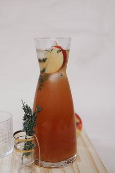 Cider Rum Punch - Dark Rum, Lemon Juice, Thyme Simple Syrup, Apple Cider, Water, Club Soda, Bitters, Thyme, Apple Wheels.