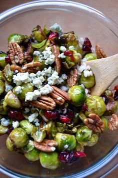 Roasted Brussel Sprouts and cranberries with walnuts- I would substitute the cheese with fresh avocado pieces.