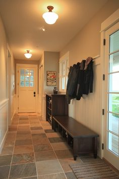 I want my mudroom/weird entry way to look like this. LOVE the floors. I am so nervous about finding a tile floor.