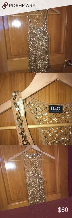 """Dolce & Gabbaba Top I wore this fabulous top over a yellow tank top, over a bathing suit, or even to the club. It is long and it covered my butt and I am 5'2"""". Great condition. Dolce & Gabbana Tops Tank Tops"""