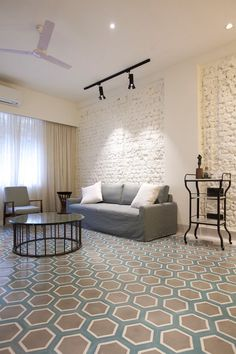 Hexagonal handmade tiles in the living room! Designed by Ravi Vazirani Design Studio. Handmade Tiles, Flooring, Contemporary, Living Room, Studio, Bedroom, Rugs, Design, Home Decor