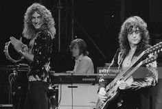 Robert Plant, John Paul Jones and Jimmy Page, of British heavy rock group Led Zeppelin, performing at Earl's Court, London, May 1975. The band were initially booked to play three nights at the venue, from 23rd to 25th May, but due to public demand, two more concerts were later added, for 17th and 18th May. Total ticket sales were 85,000.