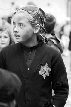 """""""Terezín... Children of the Holocaust - 007"""" by tezzer57   Picture taken in The Royal Mile, Old Town, Edinburgh, Scotland, during the Edinburgh Festival on 15 Aug 2011   Theresienstadt (Terezín's German name) Concentration Camp, also referred to as Theresienstadt Ghetto, was established by the SS during WWII in the fortress garrison city of Terezín, located in what's now the Czech Republic. During WWII it served as a Nazi concentration camp staffed by German Nazi guards."""