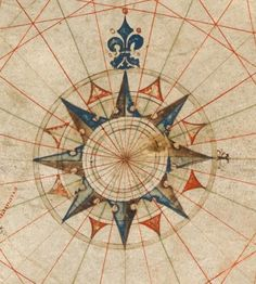 http://upload.wikimedia.org/wikipedia/commons/b/b5/Compass_rose_from_Pedro_Reinel_(1504)_chart.jpg