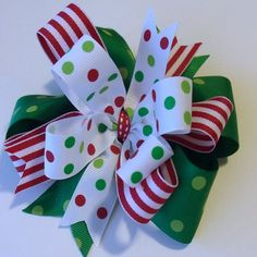 Sassy Christmas Hair Bow - Christmas Bow Grosgrain Ribbons Layered by ThePalmettoBaby on Etsy https://www.etsy.com/listing/207603252/sassy-christmas-hair-bow-christmas-bow