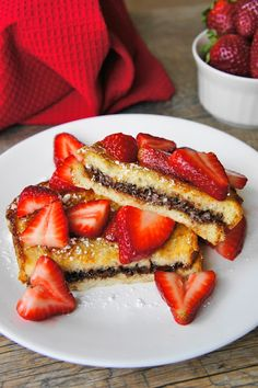 Nutella French Toast with Strawberries recipe: 1 cup sliced strawberries 2 teaspoons sugar Juice of half a lemon 4 slices of bread (I used Italian) About 1/2 cup Nutella 1 large egg 3/4 cup milk 2 tablespoons melted butter 1 teaspoon vanilla 1/4 teaspoon ground cinnamon 1/4 teaspoon salt butter (for the pan) Powdered sugar for serving