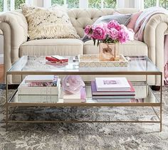 "Leona Coffee Table | Pottery Barn Overall: 44"" wide x 20.25"" deep x 17.75"" high Top: 44"" l "" wide x 20"" deep x 1"" thick Shelf: 43.25 l "" wide x 20"" deep x 1"" thick Clearance Under Stretcher: 3"" Distance Between Legs: 43.25"", 19.5"" Weight: 48 pounds"