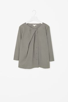 intricate tailoring and pleats on this cotton button up blouse @discovercotton…