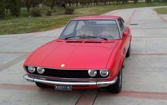 1972 Fiat Dino 2.4 Coupe - A newer version of the vehicle first shown at the Geneva Auto show in 1967, started  production at the Ferrari plant in  Maranello during late 1969 alongside the 246 Dino which, as the Lancia Stratos, shared its engine. It was fitted with a very sophisticated independent rear suspension, shared the Girling braking system used on the Lamborghini Miura and a ZF 5-speed transmission also fitted on the Aston Martins. Designed by Giorgetto Giugiaro while still at…