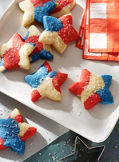 Little helpers will love cutting these Red, White & Blue Tie Dye Cookies into star shapes. Enjoy them while watching a Fourth of July parade!