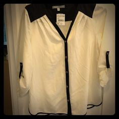 Black and white silk blouse with three quarter Sleeve buttoning at three quarter length. Was a gift but I already have one like that Daniel Rainn Tops Blouses
