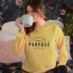 Created with A Purpose Sweatshirt | Wear this Sweater with pride knowing that a % of your purchase goes towards spreading the word of God. Part will go to building new churches, and part will go to sending missionaries around the world. Created with A Purpose Sweatshirt is not only adorable but extremely soft too! Its bold Message will be sure to turn heads! #christianapparel #womensfashion #winteroutfits #winterfashion #sweateroutfits #winteroutfits #sweater #womenssweater #valerymilano Christian Clothing, Christian Shirts, Christian Apparel, News Fashion, Fashion Tips, Fashion Women, Fashion Ideas, Women's Fashion, Sweaters For Women