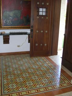 Avente Tile Project: Santiago tile #rug offers warm welcome in an entry way