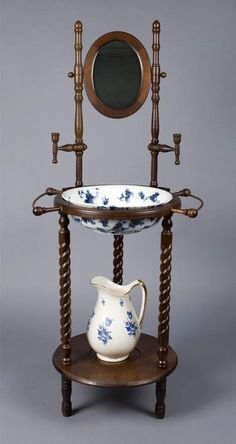 Victorian wash stand with pitcher and basin.
