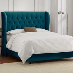 Ella Bed in Mystere Peacock (I want to put hot pink throw pillows on this and live on it forever)