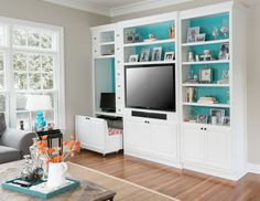 entertainment center with a pullout space-saving chair and a full-size file cabinet is under the TV