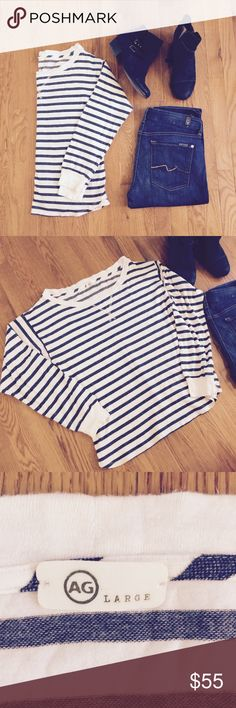 AG Adriano Goldschmied minimalist striped shirt AG Adriano Goldschmied minimalist striped shirt. Size Large. Runs true to size. Stretch knit like material. Colors are white and navy blue. Listing is for the top only. Leave me a comment if you have questions! 🙂 AG Adriano Goldschmied Tops Tees - Long Sleeve