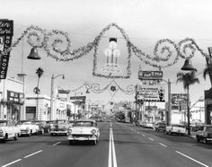 Pasadena in December. Cira 1950s. I see an Earl Scheib $29.95 paint job sign off to the right. Johnny Carson once joked that Earl Scheib would paint the whole state of California green for $29.95!