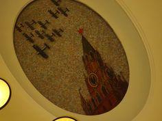 Mosaic panel of Deyneka at Mayakovskaya station picturing Kremlin. By Moscow Russia Insider's Guide.