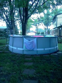 Landscaping spring 2016 outside pretties pool ideen for Above ground pool storage ideas