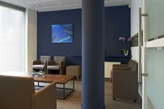 Revalidatiecentrum te Kortrijk #medical #physiotherapy #renovation #gymna #quickstep #reva-K #blue #waitingroom by architime
