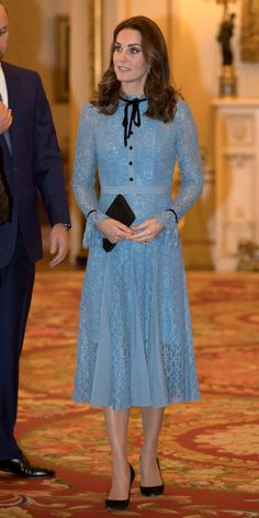 The long-sleeved, full-length dress is sweet but not too sweet, fitted but still flowing, and done in the most perfect baby blue we've seen in a long time.
