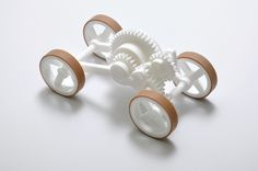 By Wouter Scheublin - This pull-back toy car is 3D printed in nylon, including all gears, axles, spring and wheels | Selective Laser Sintering (SLS)