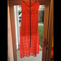 Used Orange Strapless Dress with Brown Belt Used Size Med Orange Strapless Dress w/Brown Belt Liner is knee length but the outer layer goes to your ankles...Only worn twice! From SMOKE & PET FREE HOME Dresses Strapless