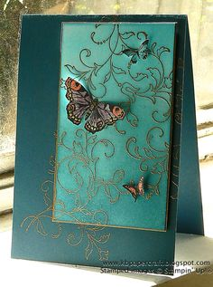 handmade card ... beautiful butterflies ... luv how the gold embossed flourishes flow off of the focal panel and onto the background ...