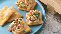 Creamy peanut sauce, cooked chicken, and seasonings atop refrigerated pie crust blend perfectly in this Asian-inspired appetizer.